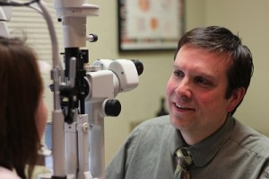 Optometrist performing eye exam